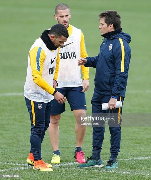 Carlos Tevez of Boca Juniors Dario Benedetto of Boca Juniors and Guillermo Barros Schelotto coach talk during a Boca Juniors Training Session at...