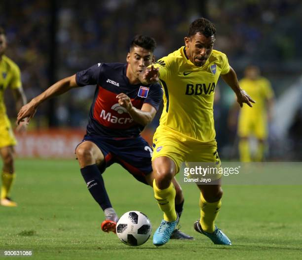 Carlos Tevez of Boca Juniors dribbles past Agustin Cardozo of Tigre during a match between Boca Juniors and Tigre as part of the Superliga 2017/18 at...