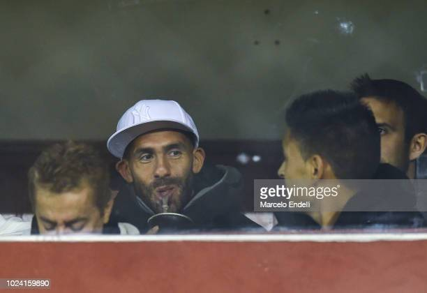 Carlos Tevez of Boca Juniors drinks Mate infusion from the stand during a match between Huracan and Boca Juniors as part of Superliga Argentina...