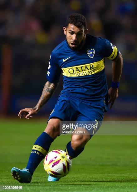 Carlos Tevez of Boca Juniors drives the ball during a match between Boca Juniors and Velez as part of Superliga Argentina 2018/19 at Estadio Alberto...