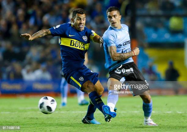 Carlos Tevez of Boca Juniors fights for the ball with Adrian Arregui of Temperley during a match between Boca Juniors and Temperley as part of the...
