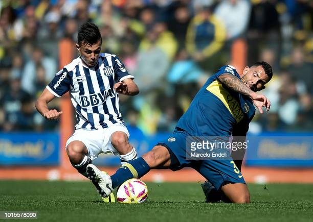 Carlos Tevez of Boca Juniors fights for the ball with Andres Cubas of Talleres during a match between Boca Juniors and Talleres as part of Superliga...