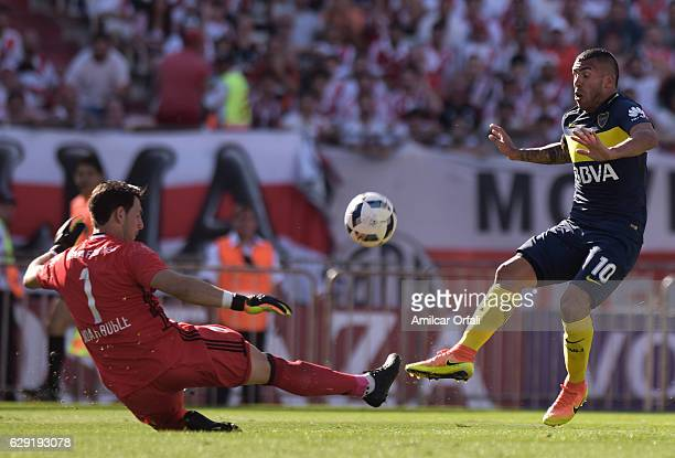 Carlos Tevez of Boca Juniors fights for the ball with Augusto Batalla goalkeeper of River Plate during a match between River Plate and Boca Juniors...