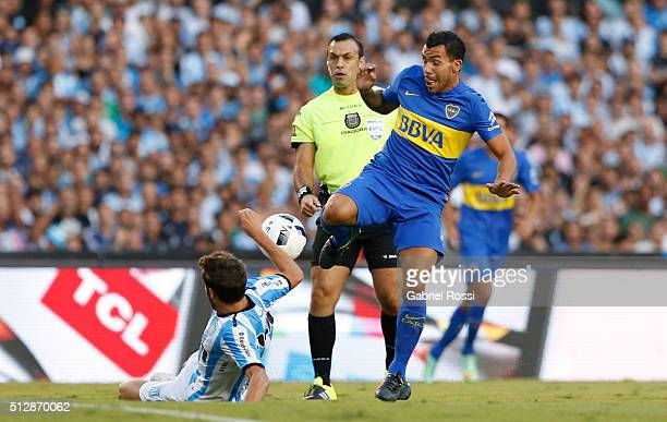 Carlos Tevez of Boca Juniors fights for the ball with Francisco Cerro of Racing Club during a fifth round match between Racing Club and Boca Juniors...