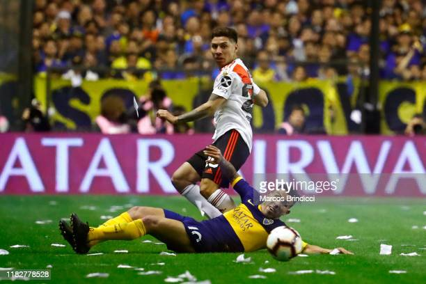 Carlos Tevez of Boca Juniors fights for the ball with Gonzalo Montiel of River Plate during the Semifinal second leg match between Boca Juniors and...
