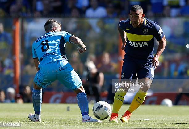 Carlos Tevez of Boca Juniors fights for the ball with Ricardo Arregui of Temperley during a match between Boca Juniors and Temperley as part of...