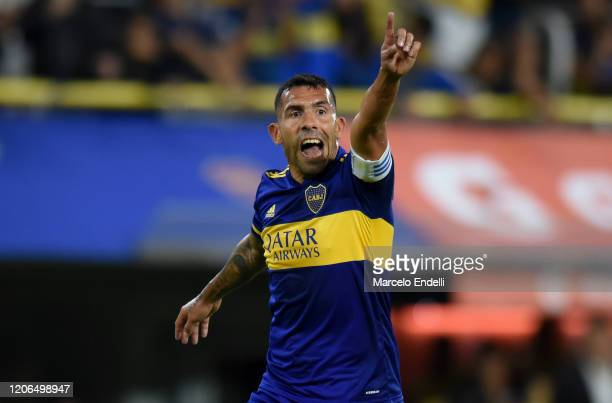 Carlos Tevez of Boca Juniors gives instructions to his teammates during a Group H match between Boca Juniors and Deportivo Independiente Medellin as...