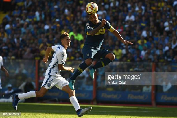 Carlos Tevez of Boca Juniors heads the ball during a match between Boca Juniors and Godoy Cruz as part of Superliga 2018/19 at Estadio Alberto J...