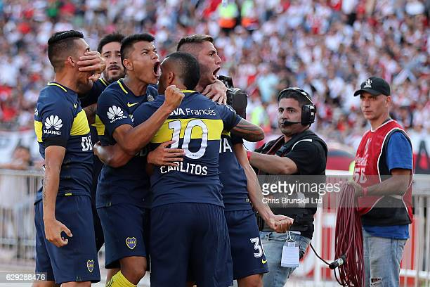 Carlos Tevez of Boca Juniors is mobbed by his teammates after scoring his side's second goal during the Argentine Primera Division match between...