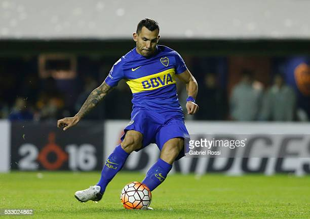 Carlos Tevez of Boca Juniors kicks from the penalty spot during a second leg match between Boca Juniors and Nacional as part of quarter finals of...