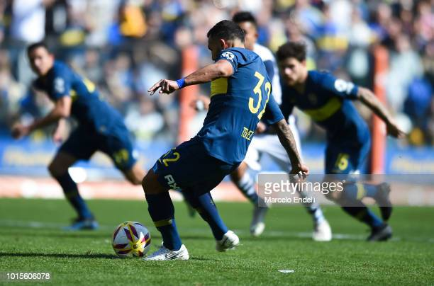 Carlos Tevez of Boca Juniors kicks the ball and misses a penalty during a match between Boca Juniors and Talleres as part of Superliga Argentina...