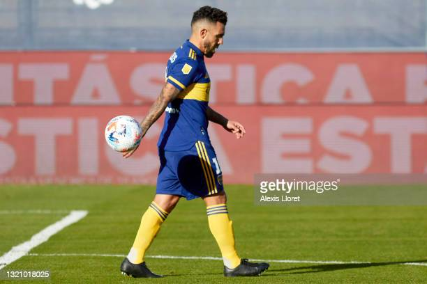 Carlos Tevez of Boca Juniors looks dejected after his team was defeated in the penalty shoot-out during a semifinal match of Copa de la Liga...