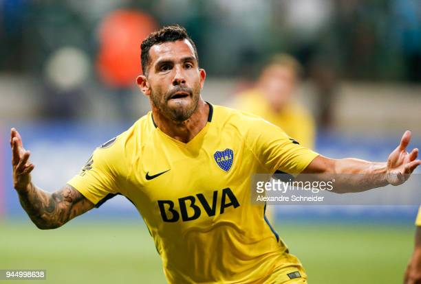 Carlos Tevez of Boca Juniors of Argentina celebrates after scoring their first goal during the match against Palmeiras of Brazil for the Copa...