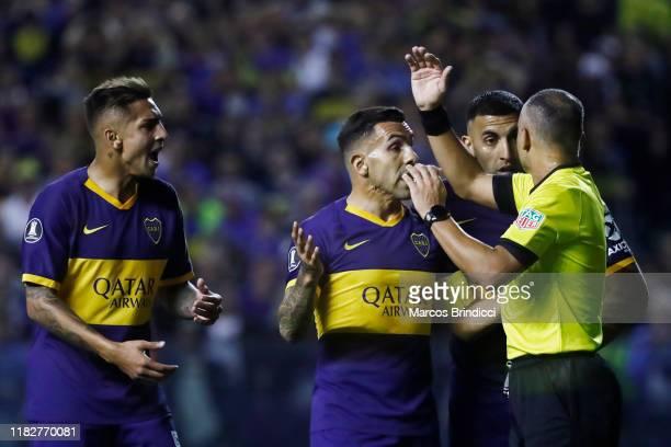 Carlos Tevez of Boca Juniors Ramon Abila of Boca Juniors and Agustin Almendra of Boca Juniors argue with Referee Wilton Sampaio after a disallowed...