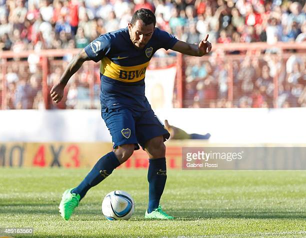 Carlos Tevez of Boca Juniors shoots to score during a match between Argentinos Juniors and Boca Juniors as part of 25th round of Torneo Primera...
