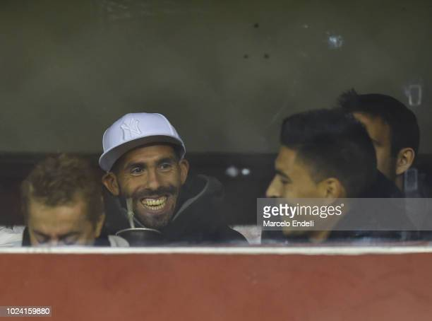 Carlos Tevez of Boca Juniors smiles from the stand during a match between Huracan and Boca Juniors as part of Superliga Argentina 2018/19 at Estadio...