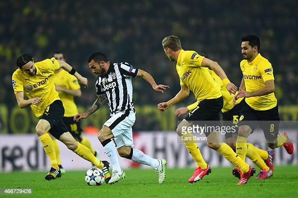 Carlos Tevez of Juventus bursts through the Borussia Dortmund defense during the UEFA Champions League Round of 16 between Borussia Dortmund and...