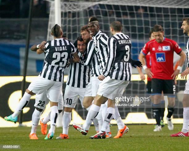 Carlos Tevez of Juventus celebrates after scoring his team's opening goal during the Serie A match between Atalanta BC and Juventus at Stadio Atleti...