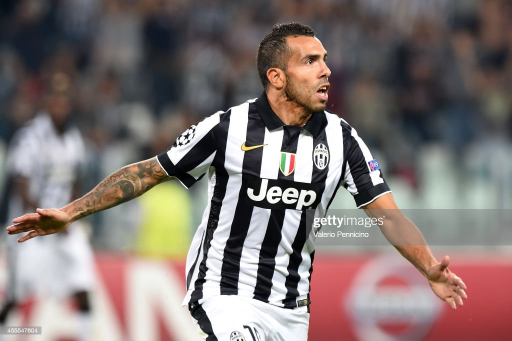 Carlos Tevez of Juventus celebrates the opening goal during the UEFA Champions League Group A match between Juventus and Malmo FF on September 16, 2014 in Turin, Italy.