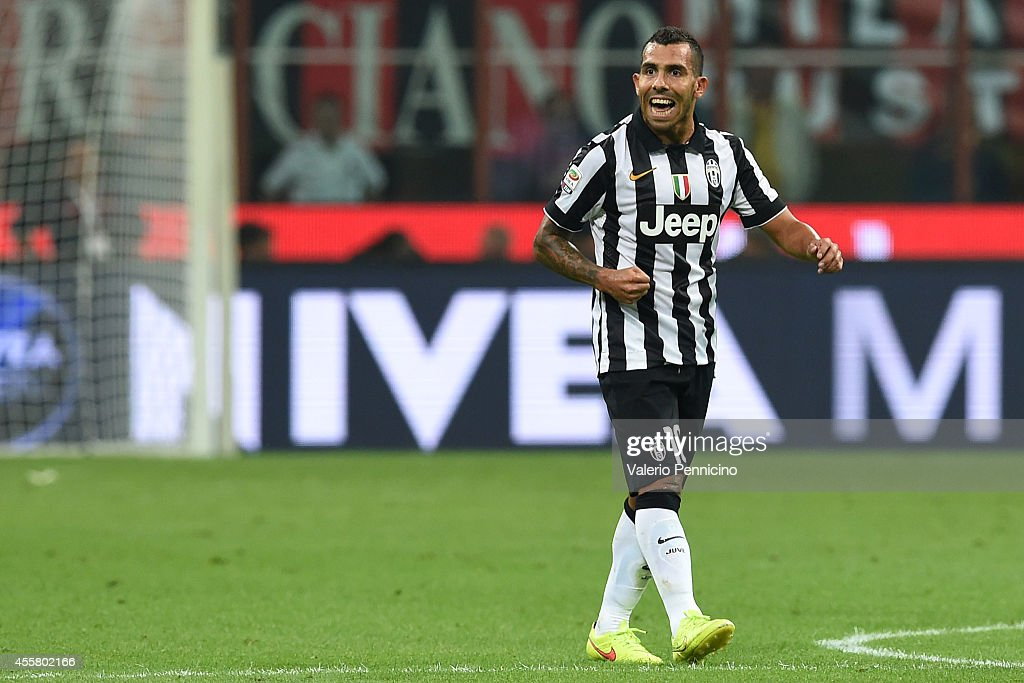Carlos Tevez of Juventus FC celebrates after scoring the opening goal during the Serie A match between AC Milan and Juventus FC at Stadio Giuseppe Meazza on September 20, 2014 in Milan, Italy.