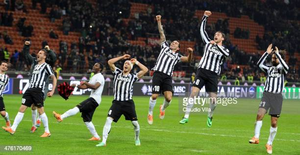 Carlos Tevez of Juventus FC celebrates victory with teammates at the end of the Serie A match between AC Milan and Juventus at San Siro Stadium on...