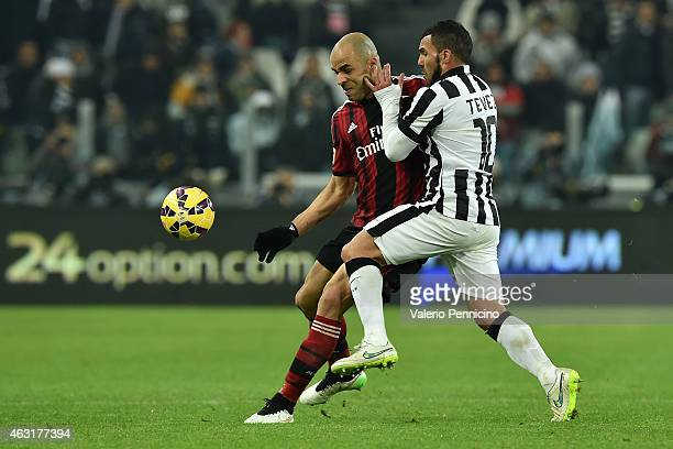Carlos Tevez of Juventus FC competes with Alex Dias Da Costa of AC Milan during the Serie A match between Juventus FC and AC Milan at Juventus Arena...