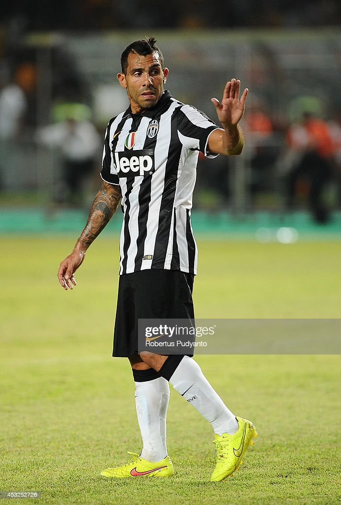 Carlos Tevez of Juventus FC in action during the pre-season friendly match between Indonesia Selection All Star Team and Juventus FC at Gelora Bung Karno Stadium on August 6, 2014 in Jakarta, Indonesia. Juventus FC won the game 8-1.