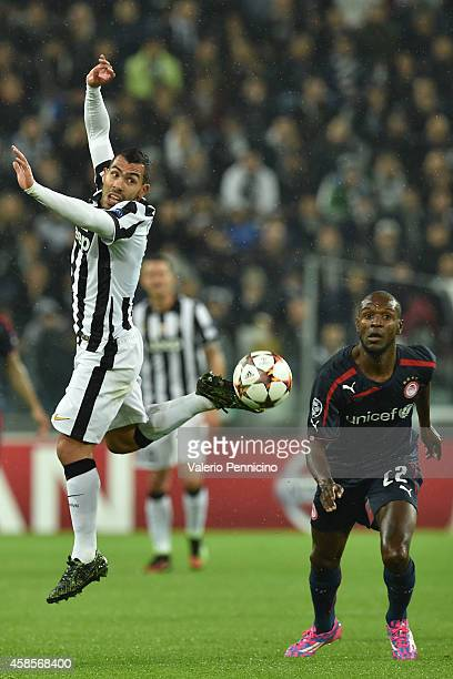Carlos Tevez of Juventus in action against Eric Abidal of Olympiacos FC during the UEFA Champions League group A match between Juventus and...