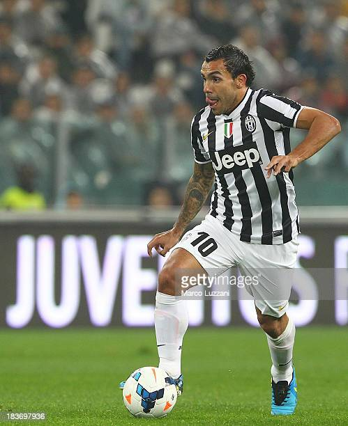Carlos Tevez of Juventus in action during the Serie A match between Juventus FC and AC Milan at Juventus Arena on October 6 2013 in Turin Italy