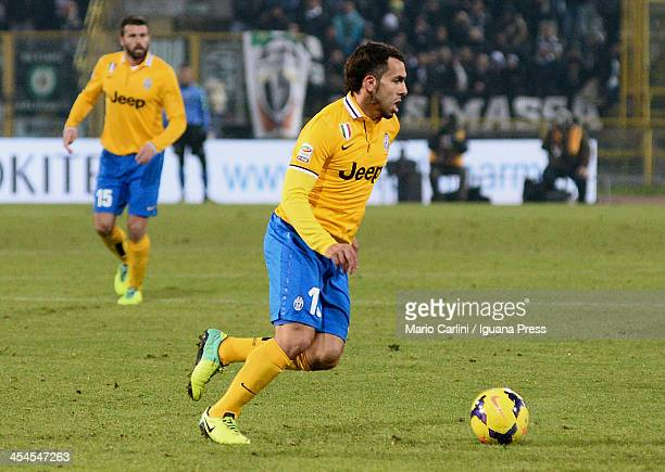 Carlos Tevez of Juventus in action during the Serie A match between Bologna FC and Juventus at Stadio Renato Dall'Ara on December 6 2013 in Bologna...