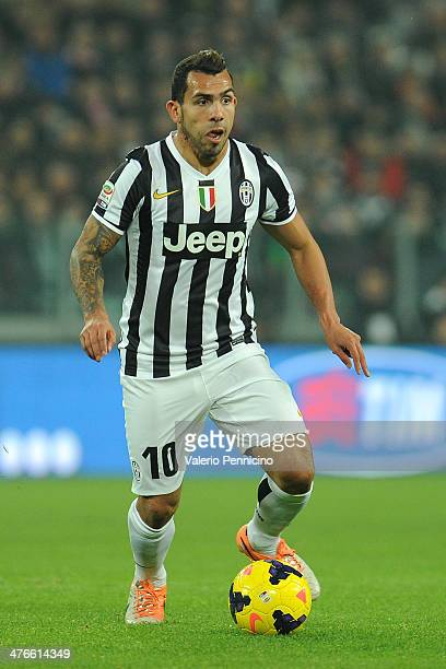 Carlos Tevez of Juventus in action during the Serie A match between Juventus and Torino FC at Juventus Arena on February 23 2014 in Turin Italy