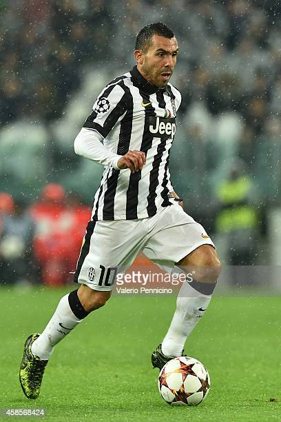 Carlos Tevez of Juventus in action during the UEFA Champions League group A match between Juventus and Olympiacos FC at Juventus Arena on November 4...