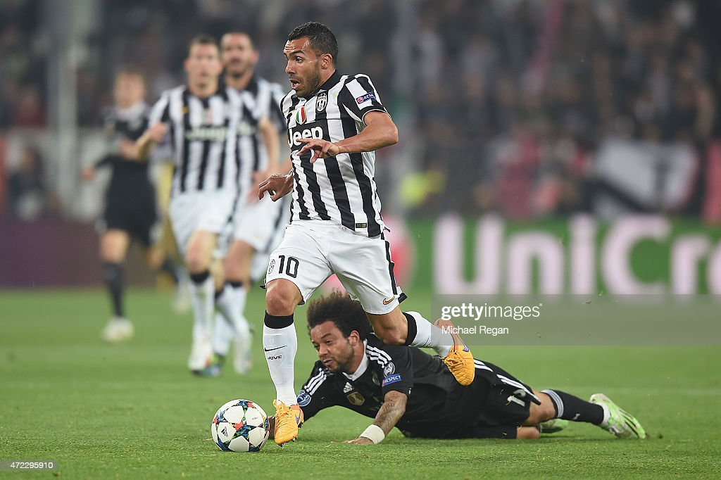 Carlos Tevez of Juventus in action with Marcelo of Real Madrid during the UEFA Champions League semi final match between Juventus and Real Madrid at Juventus Arena on May 5, 2015 in Turin, Italy.