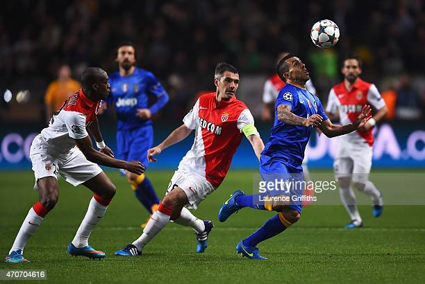 Carlos Tevez of Juventus is closed down by Jeremy Toulalan and Geoffrey Kondogbia of Monaco during the UEFA Champions League quarterfinal second leg...