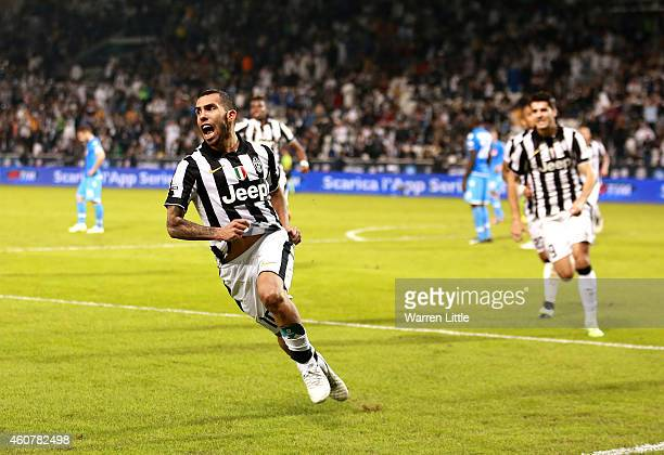 Carlos Tevez of Juventus scores his teams second goal during the 2014 Italian Super Cup match between Juventus FC v SSC Napoli at the Jassim Bin...