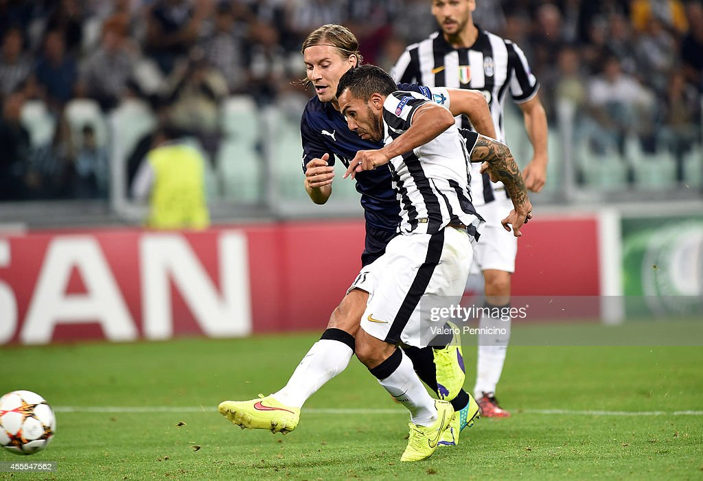 Carlos Tevez of Juventus scores the opening goal during the UEFA Champions League Group A match between Juventus and Malmo FF on September 16, 2014 in Turin, Italy.
