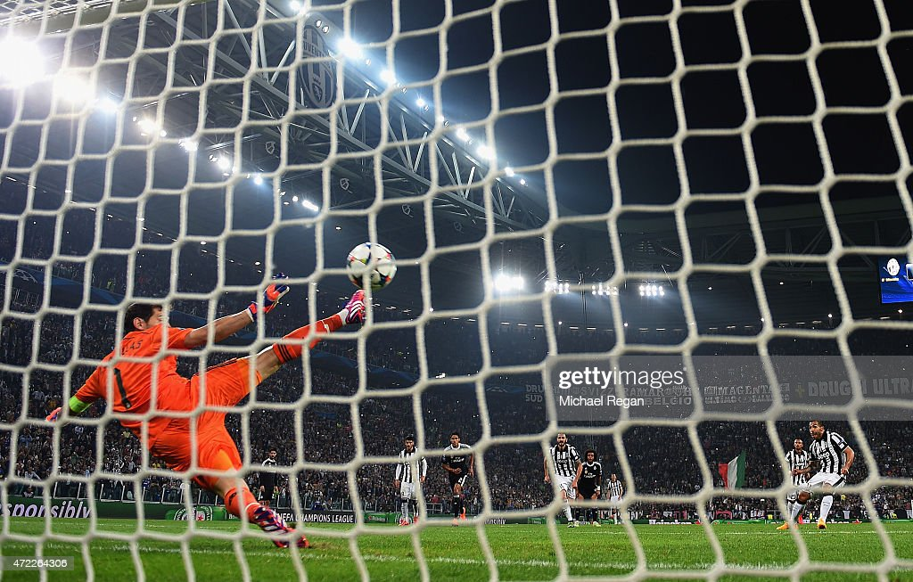 Carlos Tevez of Juventus scores their second goal from a penalty past goalkeeper Iker Casillas of Real Madrid CF during the UEFA Champions League semi final first leg match between Juventus and Real Madrid CF at Juventus Arena on May 5, 2015 in Turin, Italy.