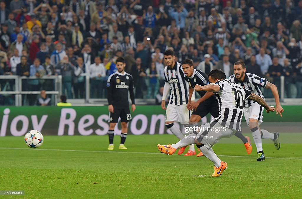 Carlos Tevez of Juventus scores their second goal from a penalty during the UEFA Champions League semi final first leg match between Juventus and Real Madrid CF at Juventus Arena on May 5, 2015 in Turin, Italy.