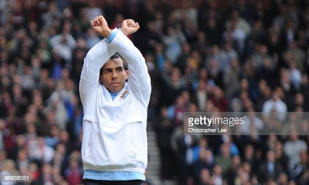 Carlos Tevez of Man City gives a Hammers sign to the West Ham fans as they cheer his name during the Barclays Premier League match between West Ham...