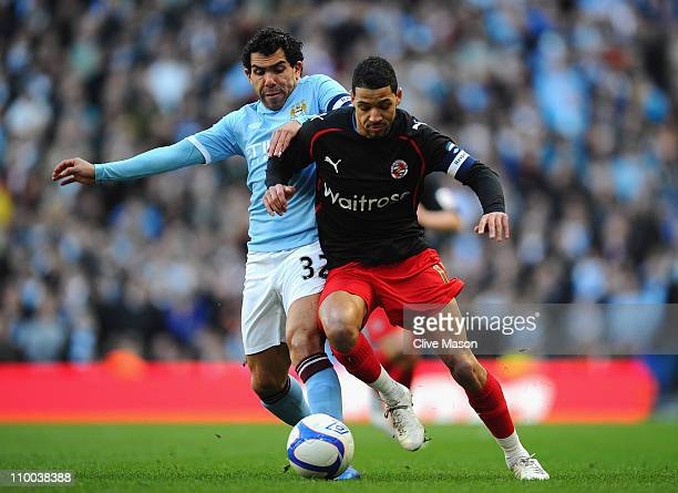 Carlos Tevez of Manchester City and Jobi McAnuff of Reading battle for the ball during the FA Cup sponsored by EOn Sixth Round match between...