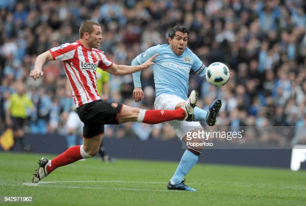 Carlos Tevez of Manchester City and Phil Bardsley of Sunderland in action during the Barclays Premier League match between Manchester City and...