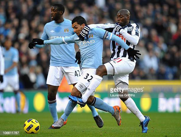 Carlos Tevez of Manchester City battles for the ball with Youssouf Mulumbu of West Bromwich Albion during the Barclays Premier League match between...