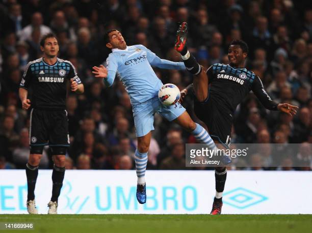 Carlos Tevez of Manchester City battles with John Obi Mikel of Chelsea during the Barclays Premier League match between Manchester City and Chelsea...