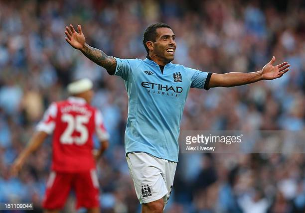Carlos Tevez of Manchester City celebrates after scoring his goal during the Barclays Premier League match between Manchester City and Queens Park...