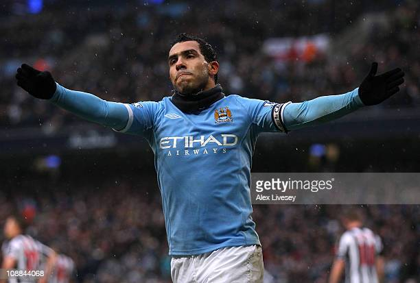 Carlos Tevez of Manchester City celebrates after scoring his third goal during the Barclays Premier League match between Manchester City and West...