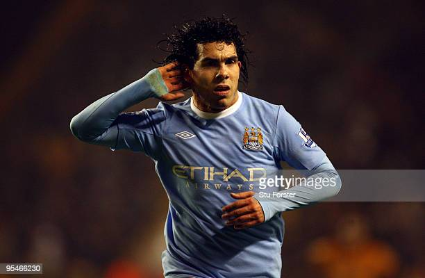 Carlos Tevez of Manchester City celebrates after scoring the third goal during the Barclays Premier League match between Wolverhampton Wanderers and...