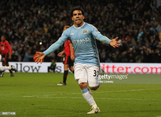 Carlos Tevez of Manchester City celebrates scoring his team's first goal during the Carling Cup Semi Final match between Manchester City and...