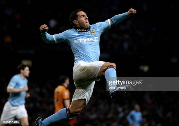 Carlos Tevez of Manchester City celebrates scoring his team's second goal during the Barclays Premier League match between Manchester City and...