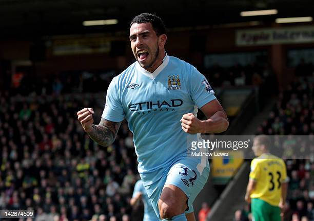 Carlos Tevez of Manchester City celebrates scoring his team's third goal during the Barclays Premier League match between Norwich City and Manchester...