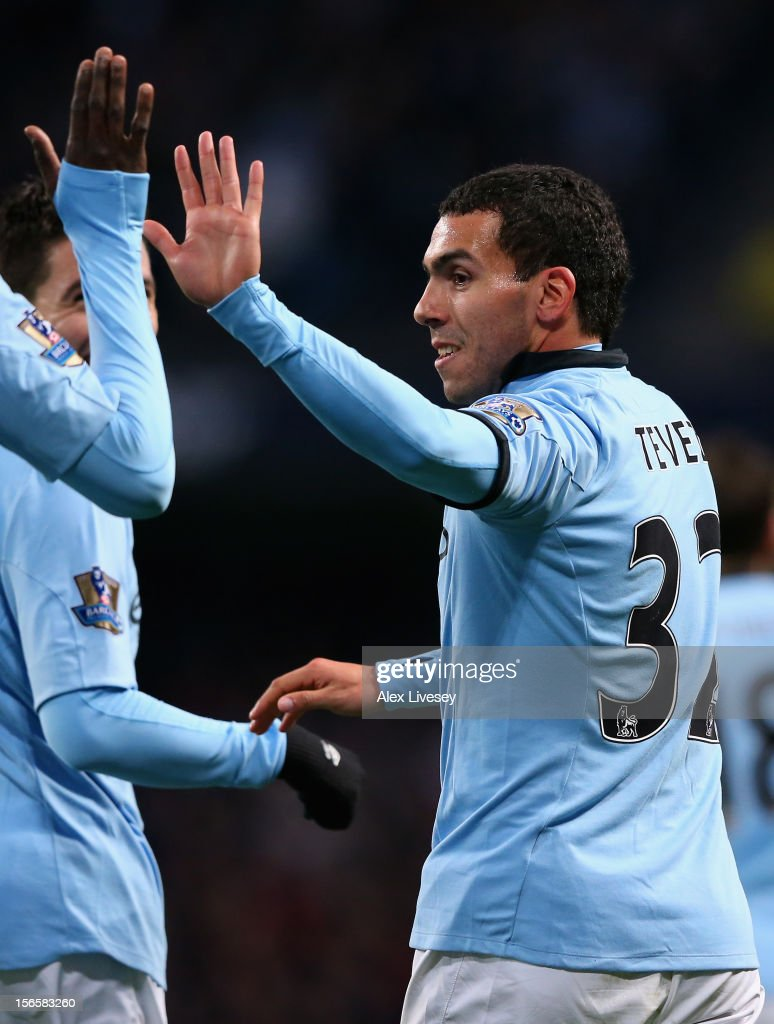 Carlos Tevez of Manchester City celebrates scoring his team's third goal from the penalty spot, to make the score 3-0 during the Barclays Premier League match between Manchester City and Aston Villa at the Etihad Stadium on November 17, 2012 in Manchester, England.